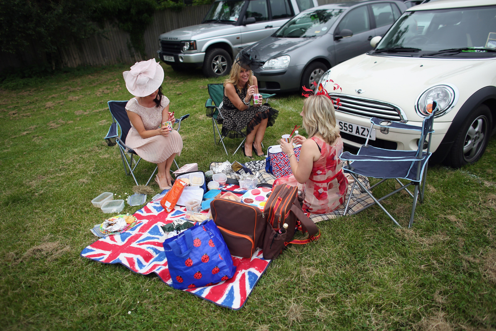 . Racegoers picnic by their car adjacent to Ascot racecourse before attending Royal Ascot on June 20, 2013 in Ascot, England. The \'Royal Ascot\' horse race meeting runs from June 18, 2013 until June 22, 2013 and has taken place since 1711. The racecourse is expected to welcome around 280,000 racegoers over the five days, including Her Majesty The Queen and other members of the Royal Family.  (Photo by Oli Scarff/Getty Images)