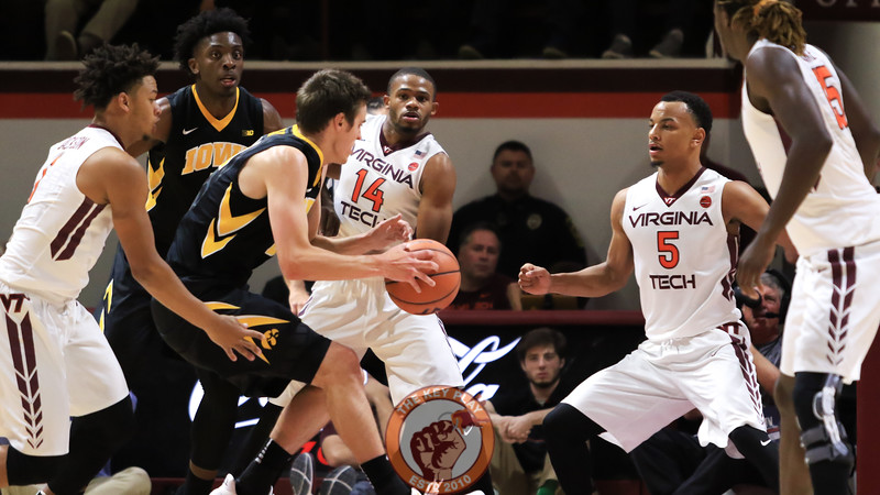 A rafter of Hokies surrounds the ball on defense. (Mark Umansky/TheKeyPlay.com)