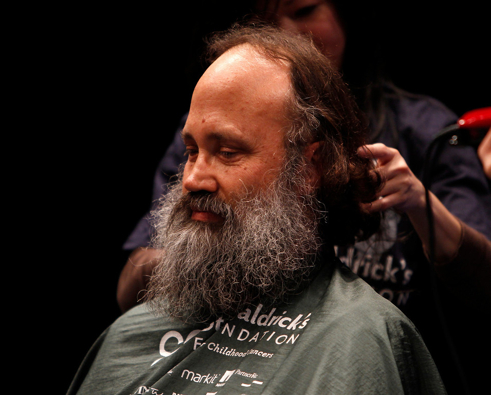 . Rick Ehrhart prepares to have his head shaved for the St. Baldrick\'s Day head shaving event in support of research for pediatric cancer sponsored by the St. Baldrick\'s Foundation in the NetApp gymnasium at NetApp in Sunnyvale, Calif., on Thursday, March 14, 2013.  (Nhat V. Meyer/Staff)