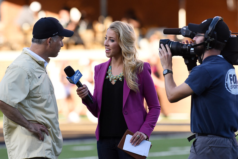 Olvia Harlan interviews Coach Clawson at half.jpg