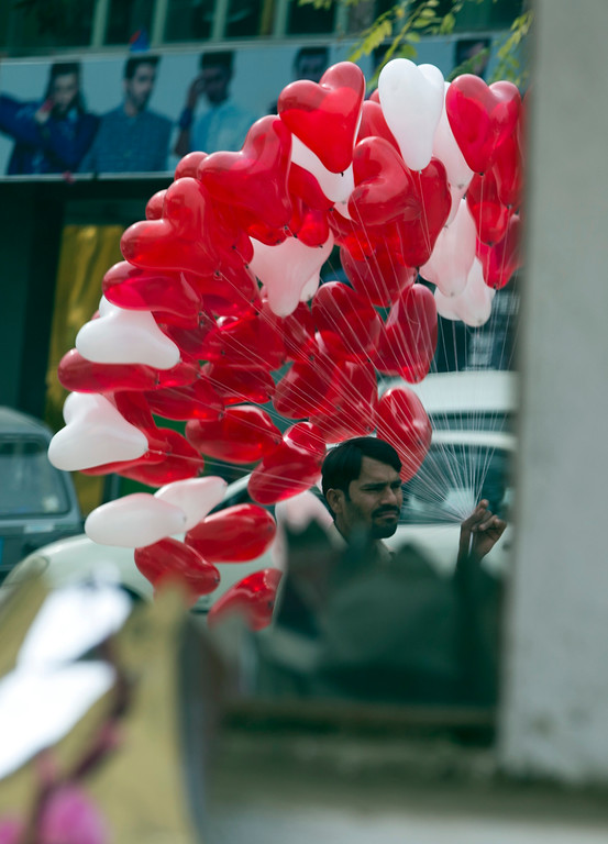 . A Pakistani vendor, seen in a mirror, sells heart-shaped balloons at a flower market, to celebrate Valentine\'s Day, in Islamabad, Pakistan, Tuesday, Feb. 14, 2017. A Pakistani judge has banned Valentine\'s Day celebrations in the country\'s capital, saying they are against Islamic teachings. A court official says the judge ruled on a petition seeking to ban public celebrations. Islamist and rightwing parties in Pakistan view Valentine\'s Day as a vulgar Western import. (AP Photo/B.K. Bangash)