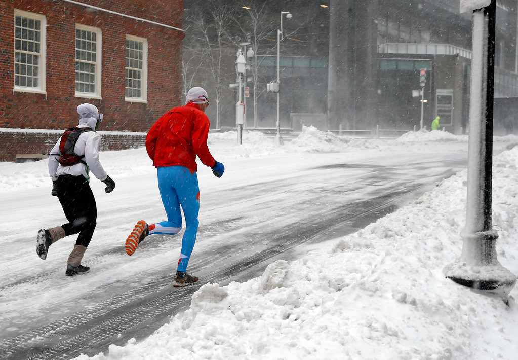. Runners brave a snowstorm, Tuesday, March 13, 2018, in Boston. (AP Photo/Michael Dwyer)