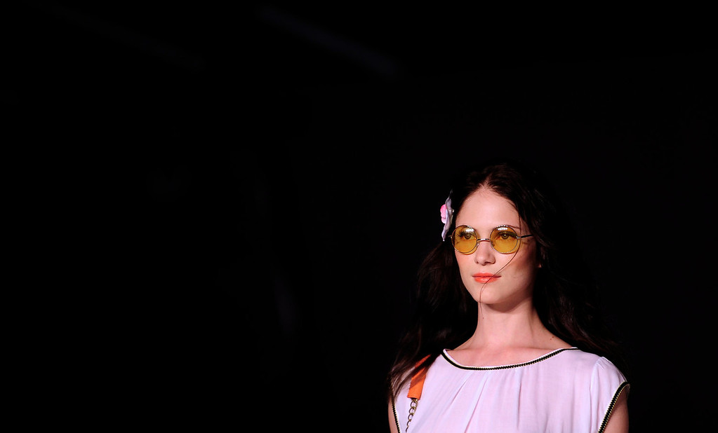 . A model wears a creation from Desigual during a 080 Barcelona fashion show in Barcelona, Spain, Tuesday, July 9, 2013.  (AP Photo/Manu Fernandez)