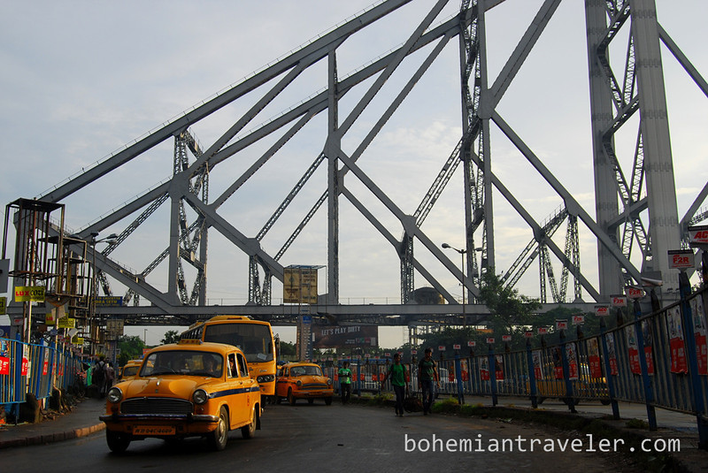 Yellow cab and Howrah Bridge.jpg