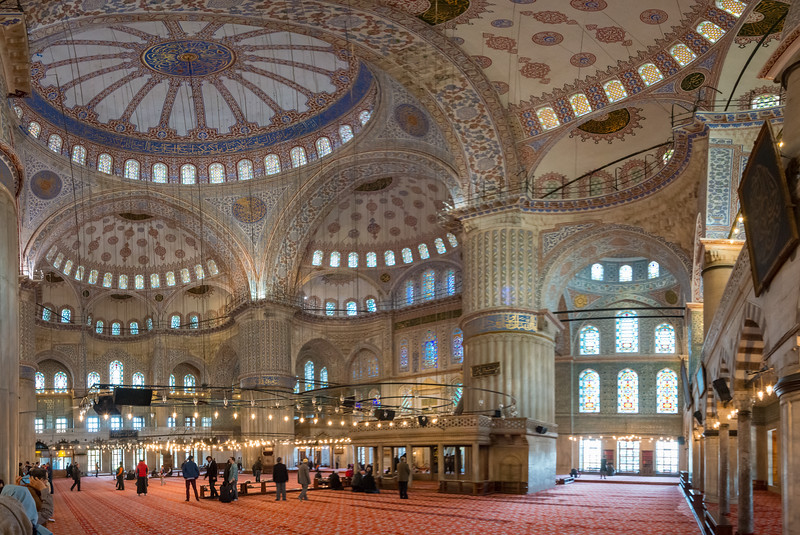 Inside the panoramic Blue Mosque (Sultanahmet Camii) Sultan Ahmed Mosque is a historic mosque located in Istanbul, Turkey. A functioning mosque, attracting very large numbers of tourist visitors. It was constructed between 1609 and 1616 during the rule of Ahmed I. Its Külliye contains Ahmed's tomb, a madrasah and a hospice. Hand-painted blue tiles adorn the mosque's interior walls, and at night the mosque is bathed in blue as lights frame the mosque's five main domes, six minarets and eight secondary domes. It sits next to the Hagia Sophia, another popular tourist site.<br /> <br /> Istanbul, Turkey is a transcontinental city in Eurasia, straddling the Bosporus strait between the Sea of Marmara and the Black Sea.