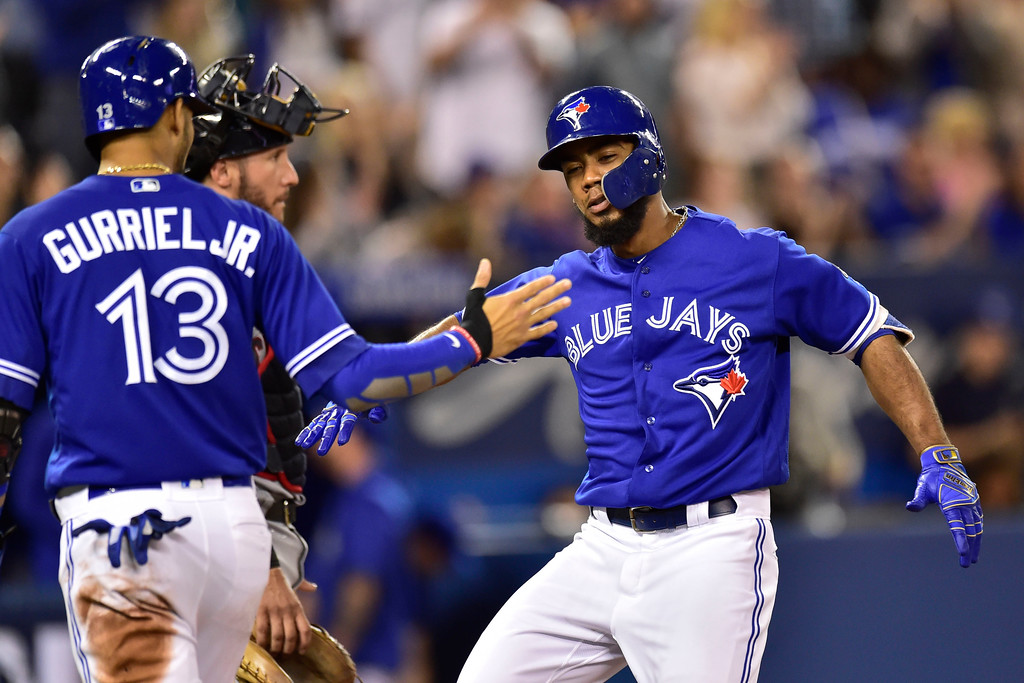 . Toronto Blue Jays Teoscar Hernandez is congratulated by teammate Lourdes Gurriel Jr. (13) after hitting a three-run home run during eighth inning baseball action against the Cleveland Indians in Toronto, Sunday, Sept. 9, 2018. (Frank Gunn/The Canadian Press via AP)