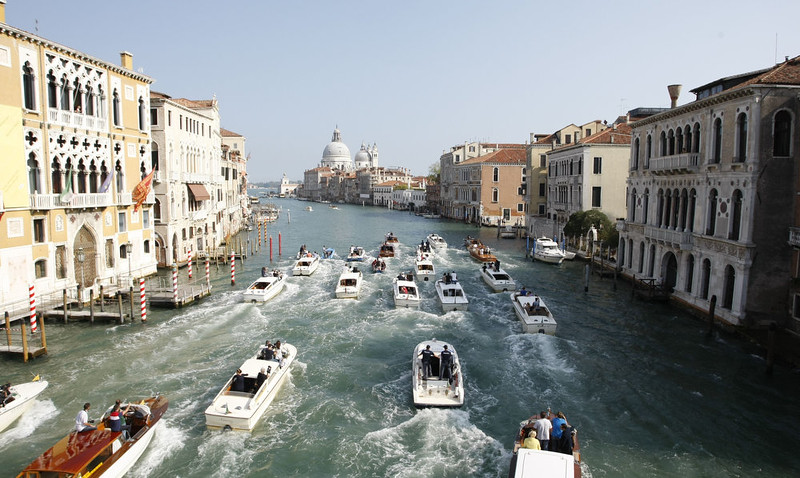 """. A general view shows boats surrounding the taxi boat of US actor George Clooney and his wife Amal Alamuddin on September 28, 2014 on the Grand Canal in Venice. Hollywood heartthrob George Clooney and Lebanese-British lawyer Amal Alamuddin married in Venice on Saturday September 27, 2014 before partying the night away with their A-list friends in one of the most high-profile celebrity weddings in years. \""""George Clooney and Amal Alamuddin were married today (September 27) in a private ceremony in Venice, Italy,\"""" Clooney spokesman Stan Rosenfield said. The announcement came as a surprise as the pair were not expected to officially tie the knot until Monday, though they are still tipped for a civil ceremony at the town hall to make the marriage official under Italian law.  PIERRE TEYSSOT/AFP/Getty Images"""