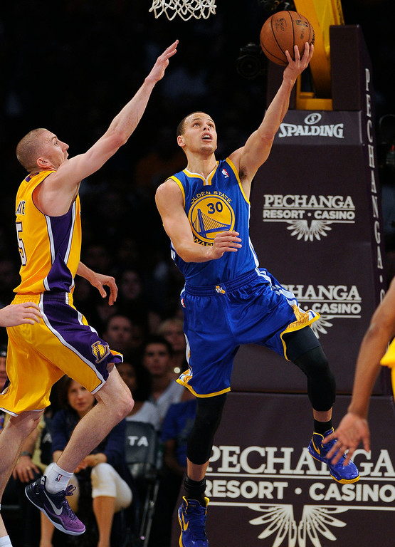 . The Warriors\'  Stephen Curry #30 lays the ball up as the Lakers\' Steve Blake #5 defends during their game at the Staples Center in Los Angeles Friday, April 12, 2013. (Hans Gutknecht/Los Angeles Daily News)