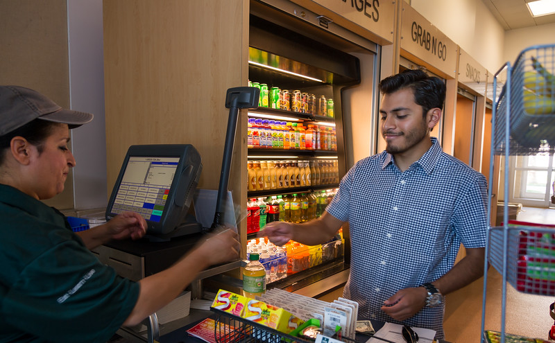 Student Thomas Valdez grabs a quick snack from Bay Hall before heading to class