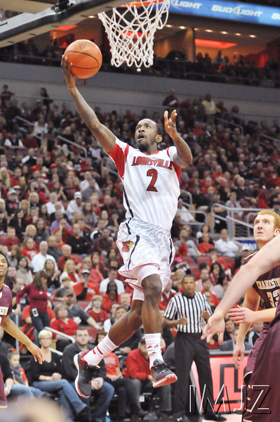 Louisville's Russ Smith drives for a lay up during the second half of the regular season opener against Charleston at the KFC YUM! Center Saturday. UofL defeated College of Charleston 70 to 48.  November 9, 2013.