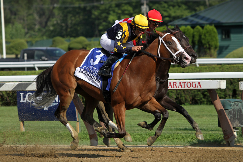 Covfefe (Into Mischief) and jockey Joel Rosario win the Test (Gr I) at Saratoga Racecourse 8/3/19. Trainer: Brad Cox. Owner: LNJ Foxwoods