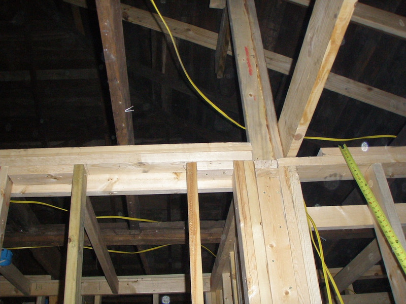 Note location of rafters on top plate.  The one on the left is the highest and the one on the right the lowest.  All of the other rafters rest on the top of the plate that you see to the right where the tape is located.