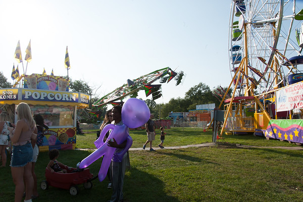 08/24/18 Wesley Bunnell | Staff Ogar Richards of Torrington holds an inflatable alien while standing in line for tickets on the opening day Friday at the Terryville Fair.