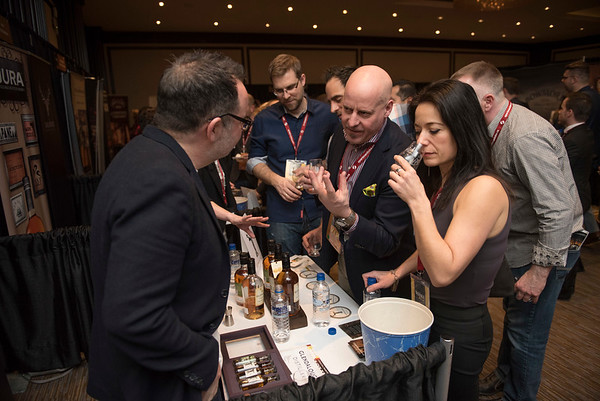 DAVID LIPNOWSKI / WINNIPEG FREE PRESS  Margaret Cunha and Kerry Wolfe speak with Gary McLoughlin of Glendalough during the 2017 Winnipeg Whiskey Festival Friday March 3, 2017 at the Fairmont Hotel.