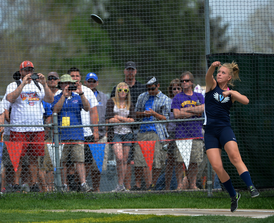 """. LAKEWOOD, CO - MAY 18:  Haley Showalter, Valor Christian, competes during the girls 4A discus throw at the Colorado State Track and Field Championships at Jeffco Stadium, Saturday morning, May 18, 2013. Showalter finished second with her longest throw at 150\' 8\"""" (Photo By Andy Cross/The Denver Post)"""
