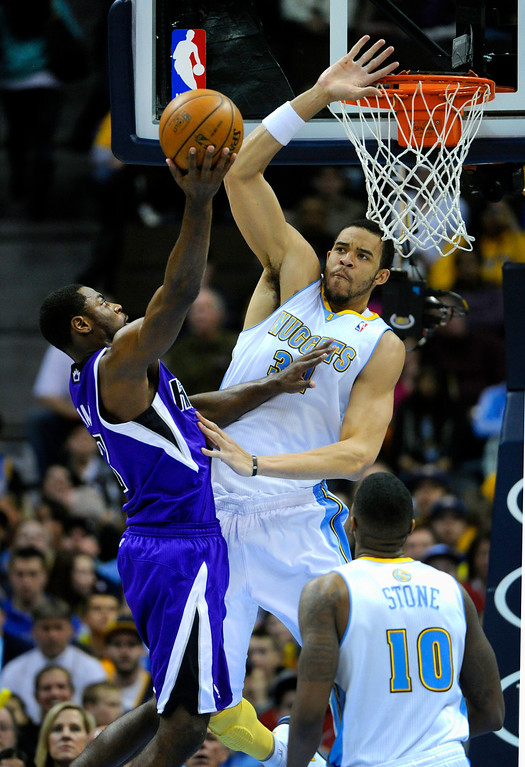 . DENVER, CO. - MARCH 22: JaVale McGee (34) of the Denver Nuggets went for a block on a shot by Tyreke Evans (13) of the Sacramento Kings in the first half. The Denver Nuggets hosted the Sacramento Kings Saturday night, March 23, 2013 at the Pepsi Center. (Photo By Karl Gehring/The Denver Post)