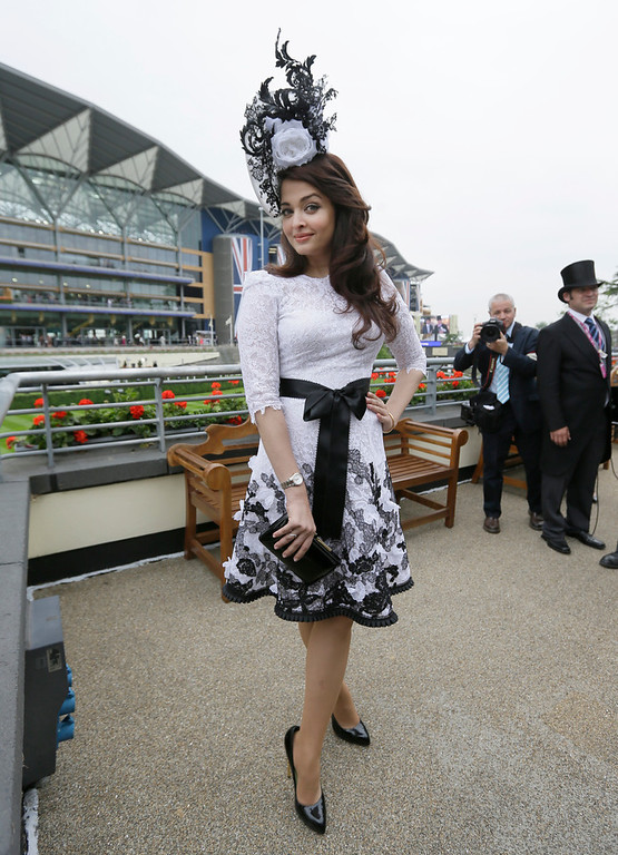 . Bollywood actress Aishwaraya Rai Bachcan poses for the media on the first day the Royal Ascot horse race meeting in Ascot, England, Tuesday, June 18, 2013. (AP Photo/Alastair Grant)