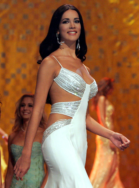 . In this May 31, 2005 file photo, Monica Spear, Miss Venezuela 2005, competes at the Miss Universe competition in Bangkok, Thailand.  Venezuelan authorities say the soap-opera actress and former Miss Venezuela and her husband were shot and killed resisting a robbery after their car broke down on Monday, Jan. 6, 2014. She was 29.   http://bit.ly/1pHR1S9 (AP Pool/Rungroj Yongrit, Pool)