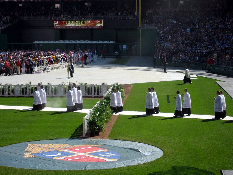 Pope Benedict XVI's procession enters the stadium through the Nationals' dugout, to begin the Mass