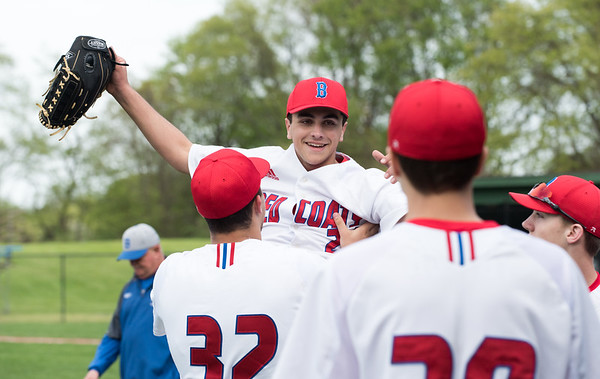05/6/19 Wesley Bunnell | Staff Berlin baseball defeated Bristol Eastern at Sage Park on Tuesday afternoon. Pitcher Mark Addamo (24) is lifted by teammate Paul D'Amour (32) after leaving the game.