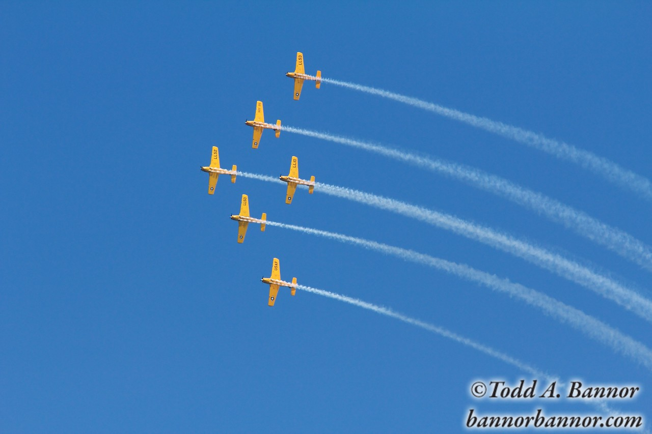 Beech T34 Mentors of the Lima Lima Precision Flight Team in formation.