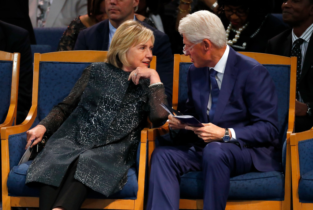. Former President Bill Clinton and wife Hillary Clinton, left, talk during the funeral service for Aretha Franklin at Greater Grace Temple, Friday, Aug. 31, 2018, in Detroit. Franklin died Aug. 16, 2018 of pancreatic cancer at the age of 76. (AP Photo/Paul Sancya)