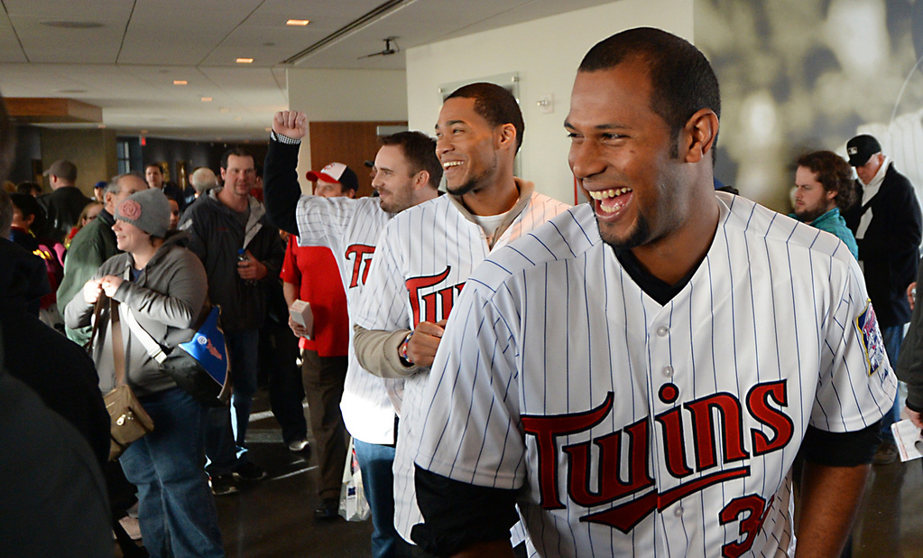. Aaron Hicks, front, Pedro Floriman, center and Brian Duensing laugh at a team mate while on their way to an autograph session at Twinsfest at Target Field, Saturday, January 25, 2014(Pioneer Press: John Autey)