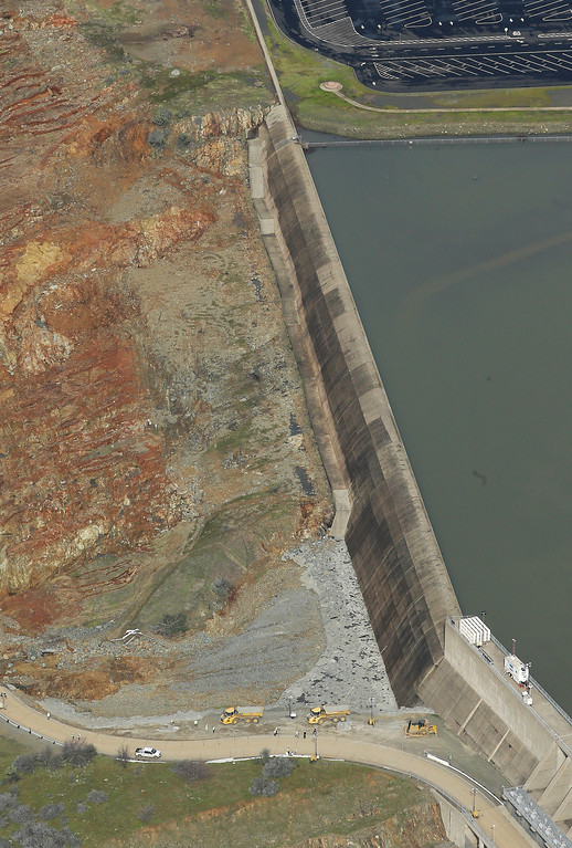 . This photo shows erosion caused when overflow water cascaded down the emergency spillway of Oroville Dam, Monday, Feb. 13, 2017, in Oroville, Calif. Water levels dropped Monday at the nation\'s tallest dam, easing slightly the fears of a catastrophic spillway collapse that prompted authorities to order people to leave their homes downstream. (AP Photo/Rich Pedroncelli)