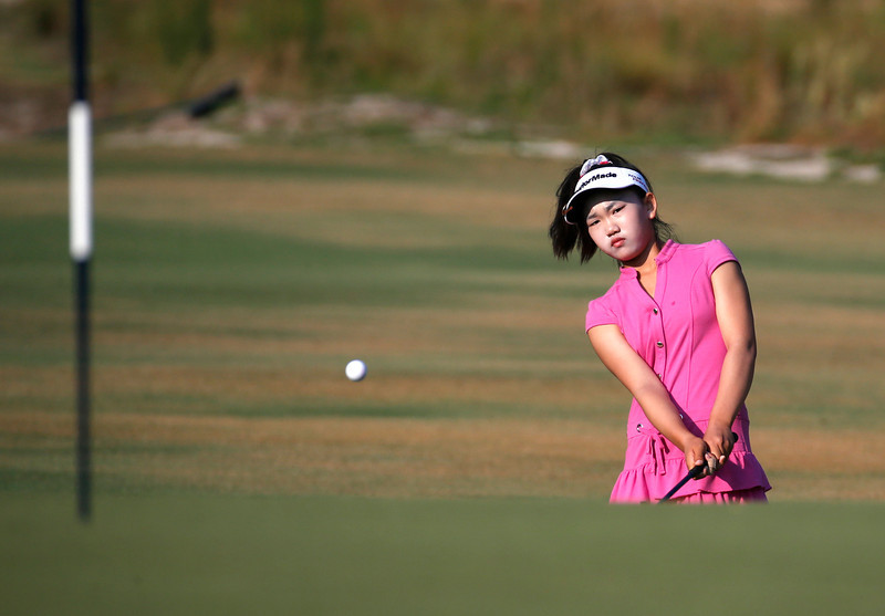 . Lucy Li chips to the second green during a practice round for the U.S. Women\'s Open golf tournament in Pinehurst, N.C., Wednesday, June 18, 2014. The sixth-grader from California is the youngest qualifier in the history of the U.S. Women\'s Open. (AP Photo/John Bazemore)