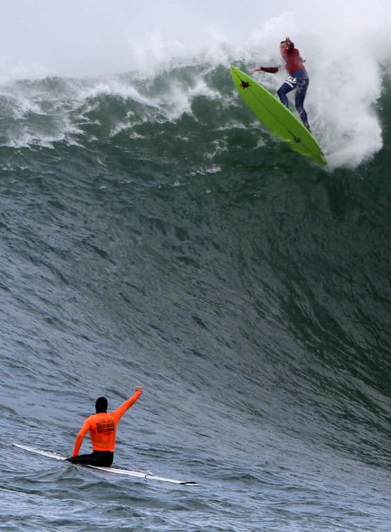 . Anthony Tashnick wipes out atop a large wave during the first semifinal heat of the Mavericks Invitational in Half Moon Bay on Friday. (Kevin Johnson/Sentinel)