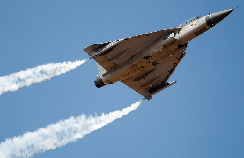 . Tejas, an Indian Air Force light combat aircraft, performs during the opening of the Aero India 2013 at Yelahanka air base in Bangalore, India, Wednesday, Feb. 6, 2013. More than 600 aviation companies along with delegations from 78 countries are participating in the five-day event that started Wednesday. (AP Photo/Aijaz Rahi)