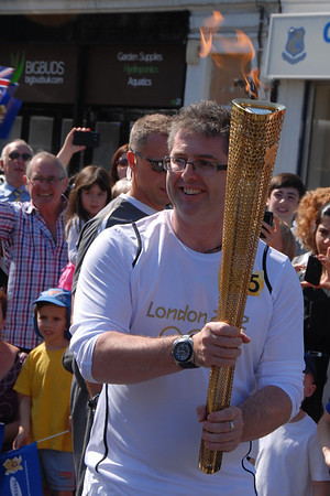 James Allen carries the Olympic Flame