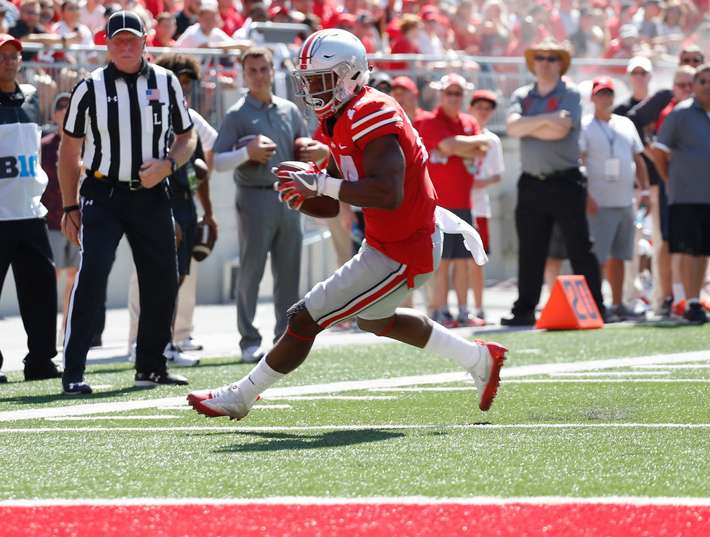 . Ohio State receiver K.J. Hill scores a touchdown against UNLV during the first half of an NCAA college football game Saturday, Sept. 23, 2017, in Columbus, Ohio. (AP Photo/Jay LaPrete)