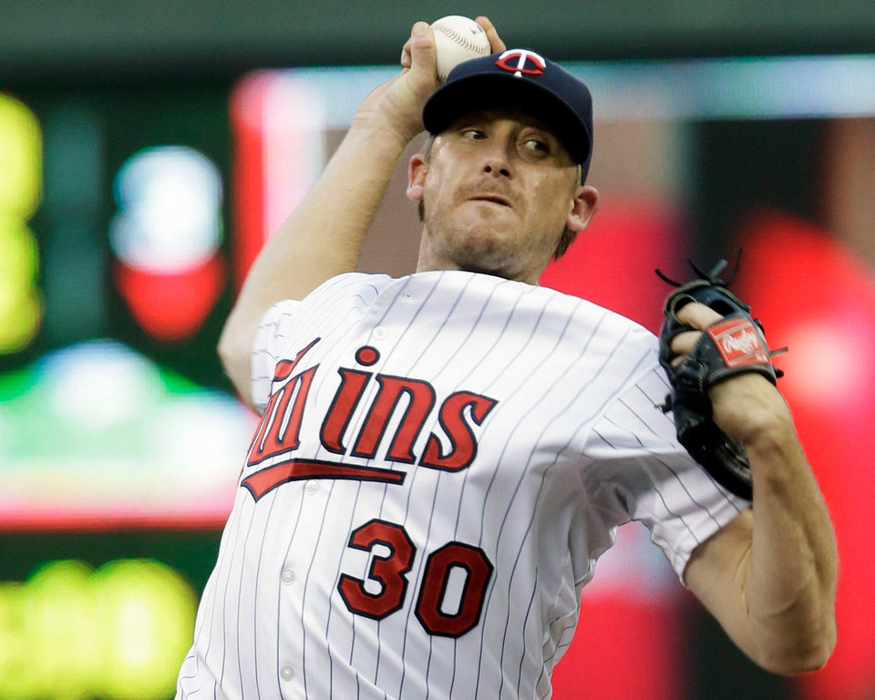 . Minnesota Twins pitcher Kevin Correia throws against the Kansas City Royals in the first inning of a baseball game, Tuesday, Aug. 27, 2013 in Minneapolis. (AP Photo/Jim Mone)