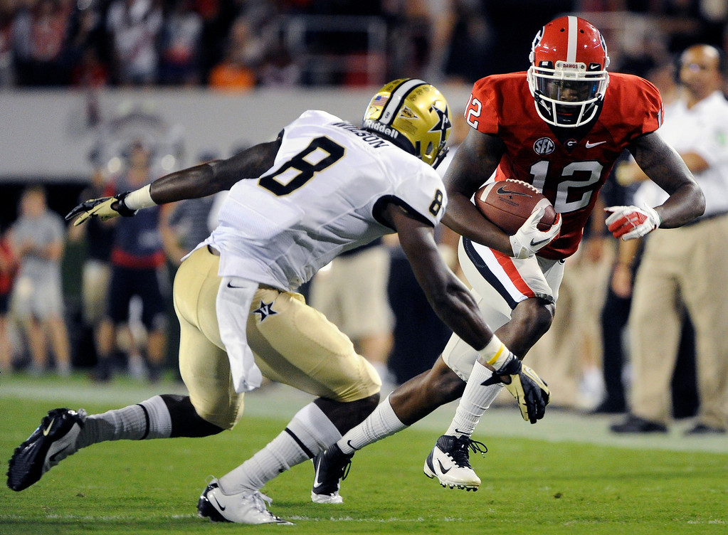 . Georgia wide receiver Tavarres King (12) makes yardage on a reception against Vanderbilt defensive back Trey Wilson (8) during the first quarter of an NCAA college football game, Saturday, Sept. 22, 2012, in Athens, Ga. (AP photo/John Amis)