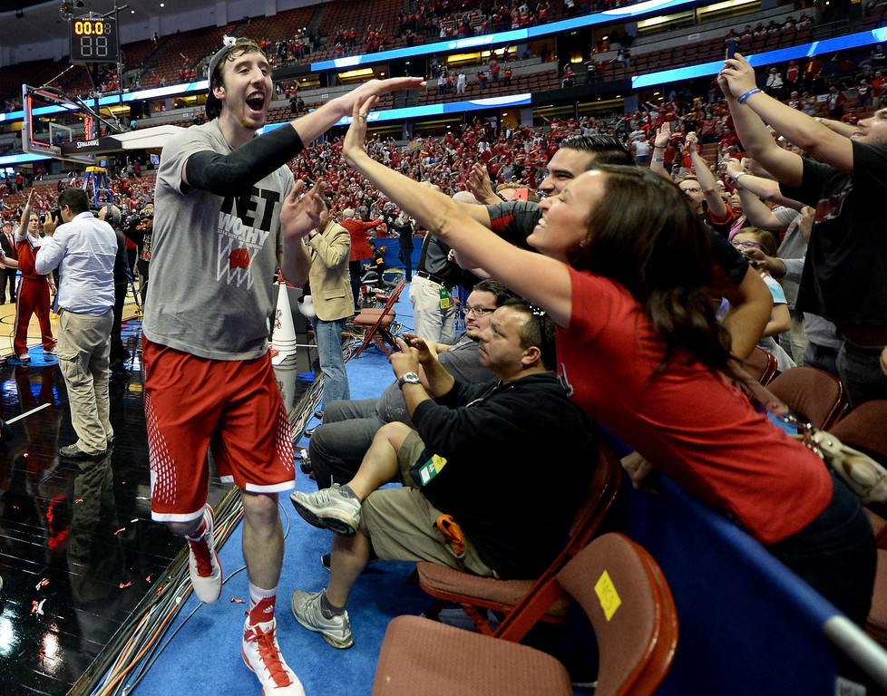 . Frank Kaminsky #44 of the Wisconsin Badgers celebrates with fans defeating the Arizona Wildcats 64-63 in overtime during the West Regional Final of the 2014 NCAA Men\'s Basketball Tournament at the Honda Center on March 29, 2014 in Anaheim, California.  (Photo by Harry How/Getty Images)