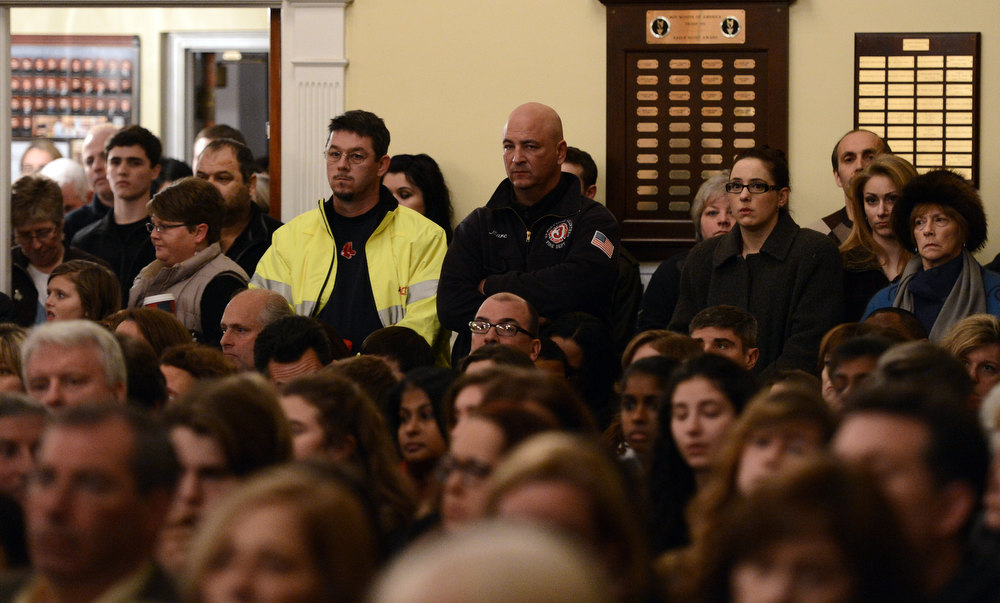 Description of . Mourners gather inside the St. Rose of Lima Roman Catholic Church at a vigil service for victims of the Sandy Hook School shooting December 14, 2012 in Newtown, Connecticut. Twenty-seven people are dead, including 20 children, after a gunman identified as Adam Lanza in news reports opened fire in the school. Lanza also reportedly died at the scene.  (Photo by Andrew Gombert-Pool/Getty Images)