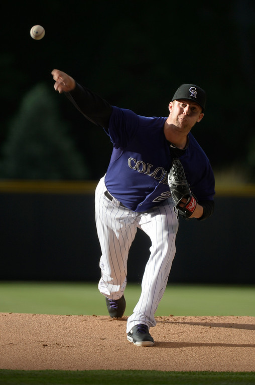 . Colorado Rockies starting pitcher Jordan Lyles (24) delivers a pitch in the first inning against the Arizona Diamondbacks June 4, 2014 at Coors Field. (Photo by John Leyba/The Denver Post)