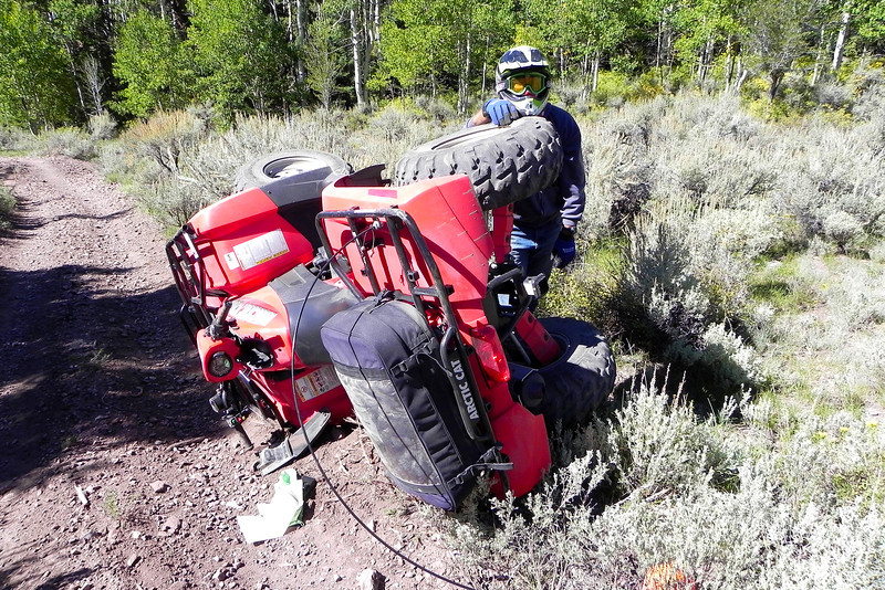 2011/9/23 – Reed Hasson was riding in front of me and when I came out of the trees I saw his ATV on its side but couldn't see him. It scared me a little and I yelled out his name. I saw his hand wave and realize he was at least alive. He had rolled and his legs were trapped under the weight of the ATV. I lifted it off of him, determined he was OK and then we took this picture to remember the event.
