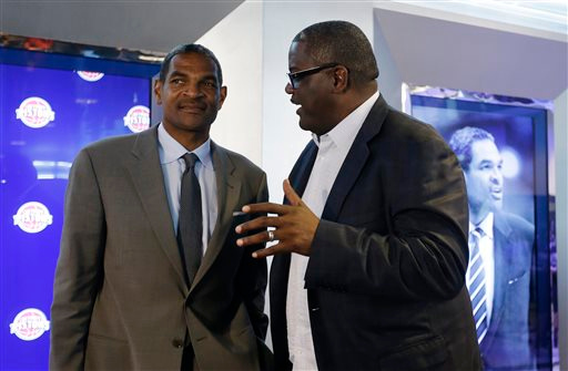 . Detroit Pistons\' President of Basketball Operations Joe Dumars, right, talks with Maurice Cheeks, left, after Cheeks was introduced as the Pistons new head coach during a news conference at The Palace of Auburn Hills, Mich., Thursday, June 13, 2013. Cheeks joins the Pistons after serving four years as an assistant coach with Oklahoma City. (AP Photo/Carlos Osorio)