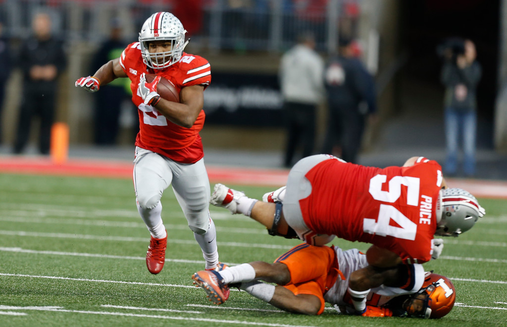 . Ohio State offensive lineman Billy Price, right, blocks for running back J.K. Dobbins, left, to run the ball against Illinois during the first half of an NCAA college football game Saturday, Nov. 18, 2017, in Columbus, Ohio. (AP Photo/Jay LaPrete)