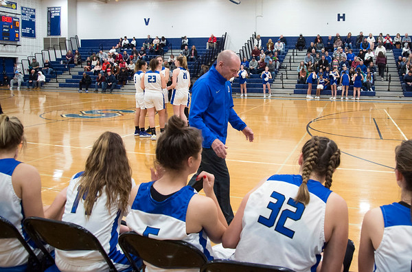 01/06/19 Wesley Bunnell | StaffrrSouthington girls basketball vs Conard on Monday night at Southington High School. Head coach Howard Hewitt walks up the sideline just prior to tipoff.