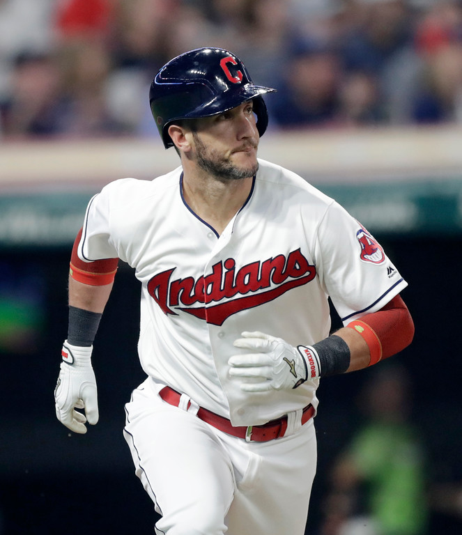 . Cleveland Indians\' Yan Gomes watches his solo home run off Minnesota Twins relief pitcher Taylor Rogers during the ninth inning of a baseball game Friday, June 15, 2018, in Cleveland. (AP Photo/Tony Dejak)