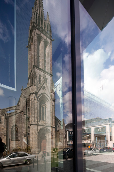 Saint Matthiew church reflected on a window glass, town of Quimper, departament of Finistere, region of Brittany, France