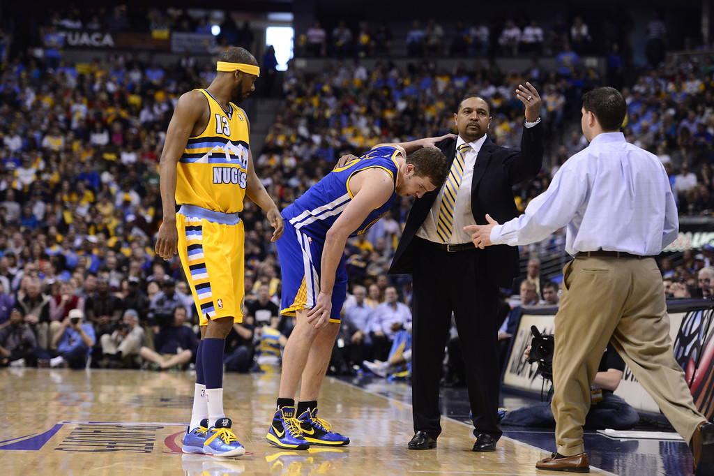 . DENVER, CO. - APRIL 20: Golden State Warriors power forward David Lee (10) leaves the court after getting hurt. The Denver Nuggets took on the Golden State Warriors in Game 1 of the Western Conference First Round Series at the Pepsi Center in Denver, Colo. on April 20, 2013. (Photo by AAron Ontiveroz/The Denver Post)