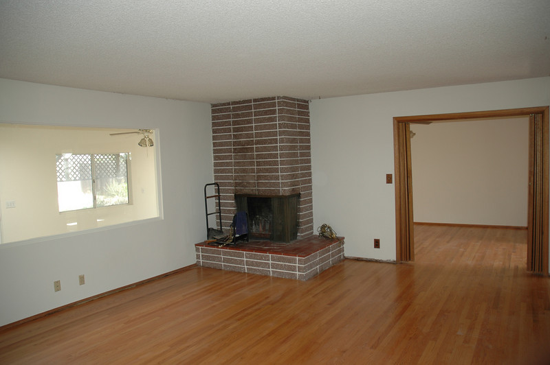 The living room has a wood burning fireplace and beautiful red oak hardwood floors.