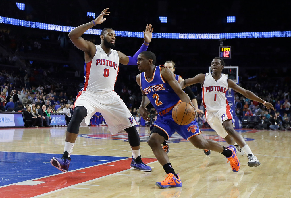 . New York Knicks guard Langston Galloway (2) drives on Detroit Pistons center Andre Drummond (0) during the first half of an NBA basketball game, Friday, Feb. 27, 2015 in Auburn Hills, Mich. (AP Photo/Carlos Osorio)