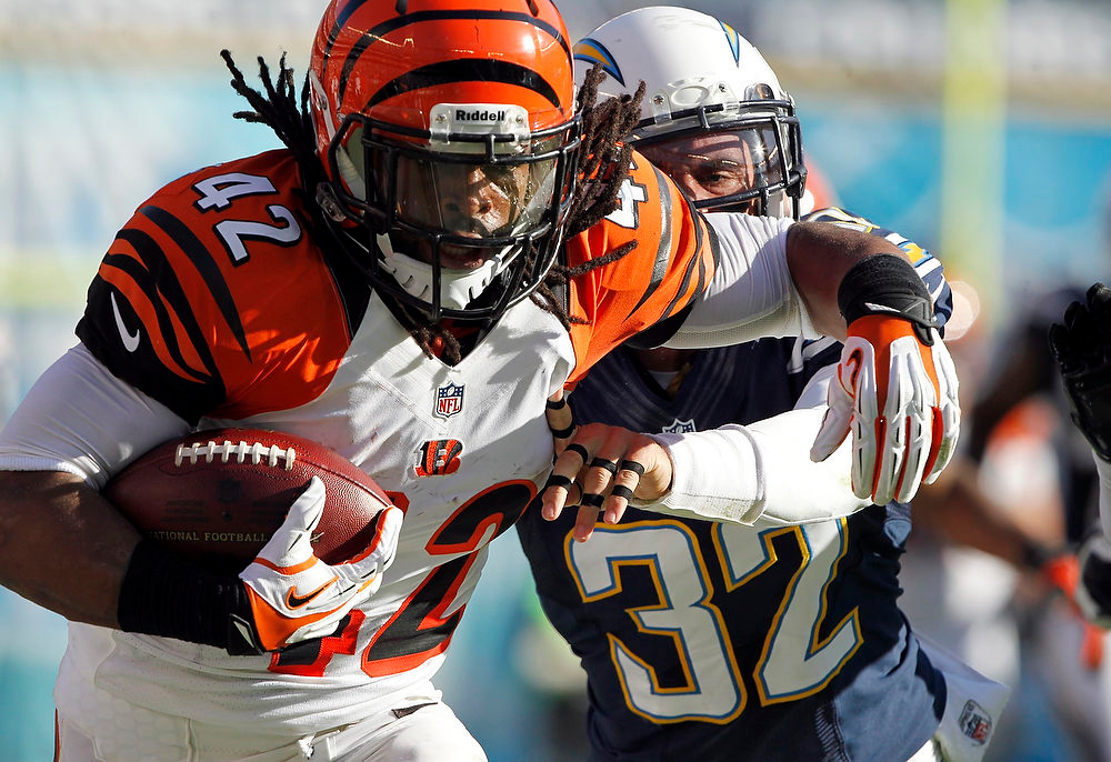 . Cincinnati Bengals running back BenJarvus Green-Ellis (42) is pushed out-of-bounds by San Diego Chargers free safety Eric Weddle (32) after a 41-yard run in the first half of their NFL football game in San Diego, California December 2, 2012.  REUTERS/Alex Gallardo