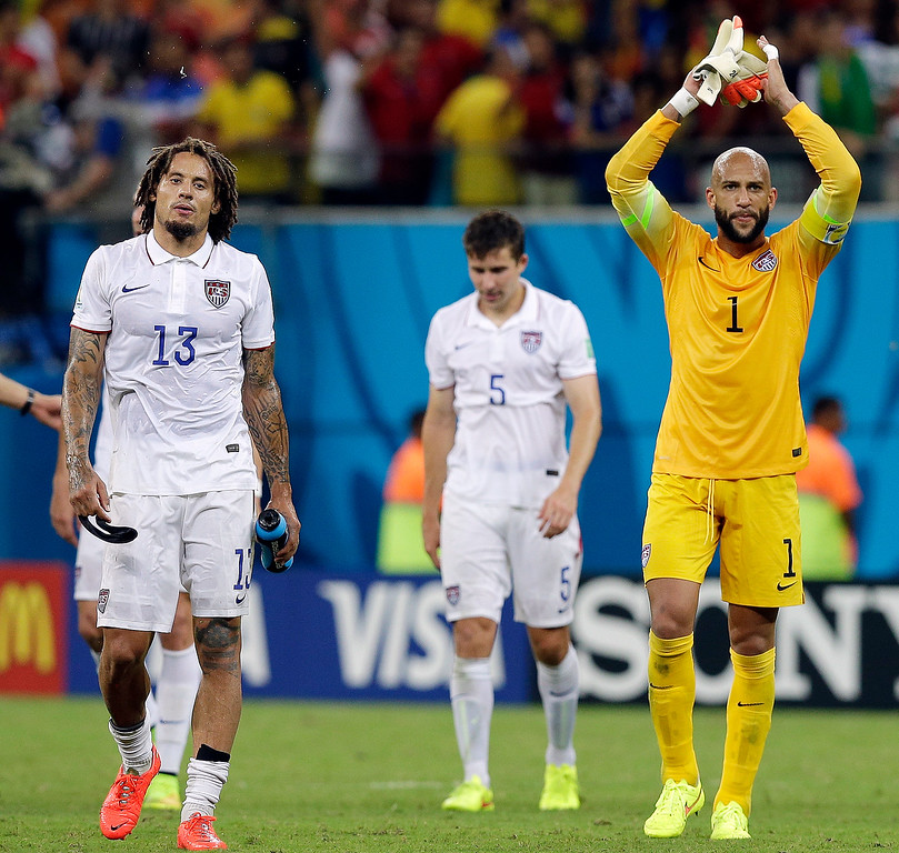 . United States\' goalkeeper Tim Howard and United States\' Jermaine Jones walk off the pitch following their 2-2 draw with Portugal during the group G World Cup soccer match between the USA and Portugal at the Arena da Amazonia in Manaus, Brazil, Sunday, June 22, 2014. (AP Photo/Martin Mejia)