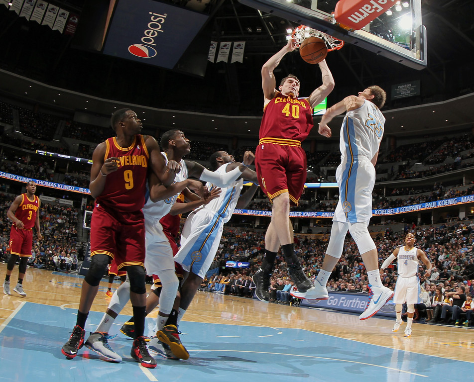 . Cleveland Cavaliers center Tyler Zeller (40) dunks ball as Denver Nuggets center Timofey Mozgov, of Russia, second from right, tries to block the shot in the first quarter of an NBA basketball game in Denver, Friday, Jan. 17, 2014. Looking on are, from left, Cavaliers forward Luol Deng, of Sudan, and Nuggets forwards Quincy Miller and J.J. Hickson. (AP Photo/David Zalubowski)